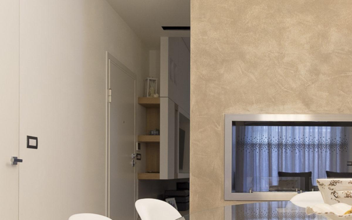 Progetto Realizzato - Interior Design - Lavoro Finito - Sala da Pranzo con biocamino passante su soggiorno